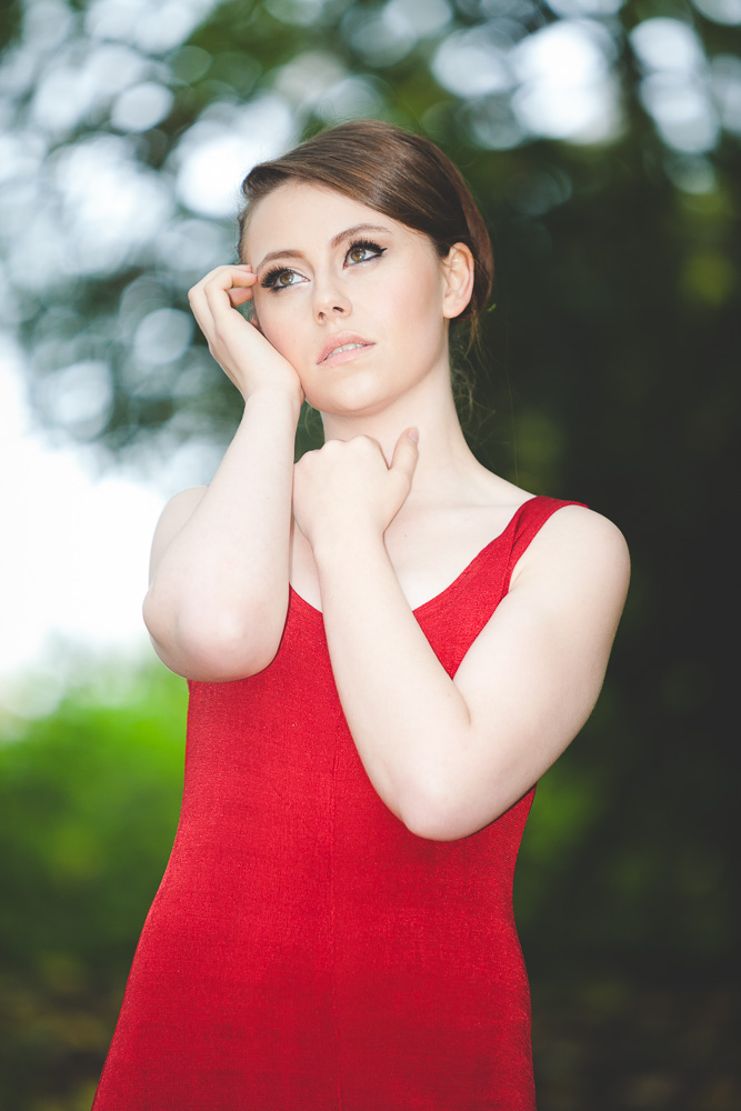 Girl posing wearing red dress