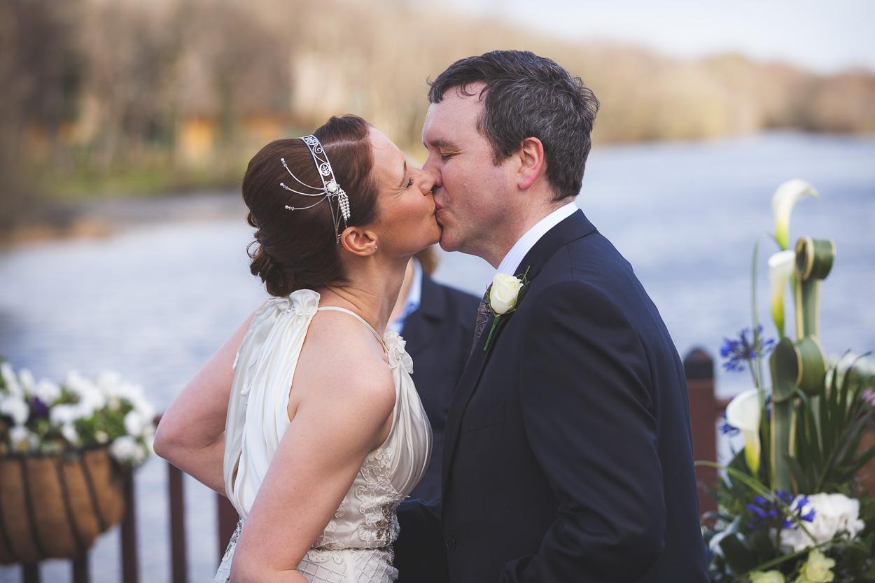Lusty Beg Wedding Ceremony Kiss