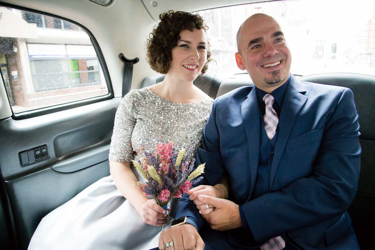 Belfast Wedding couple in taxi