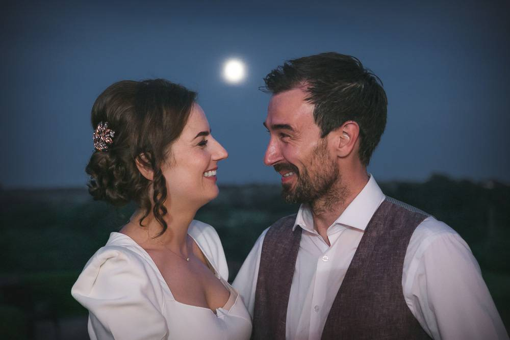 Bride and Groom with Full Moon