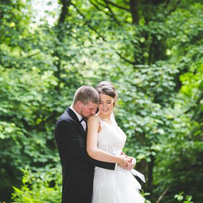 Bride and Groom in Forest Kissing Smiling
