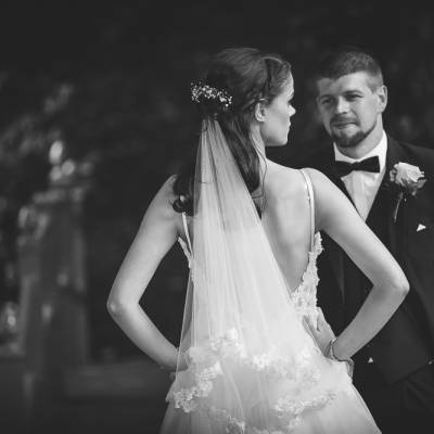 Bride with back turned looking at Groom