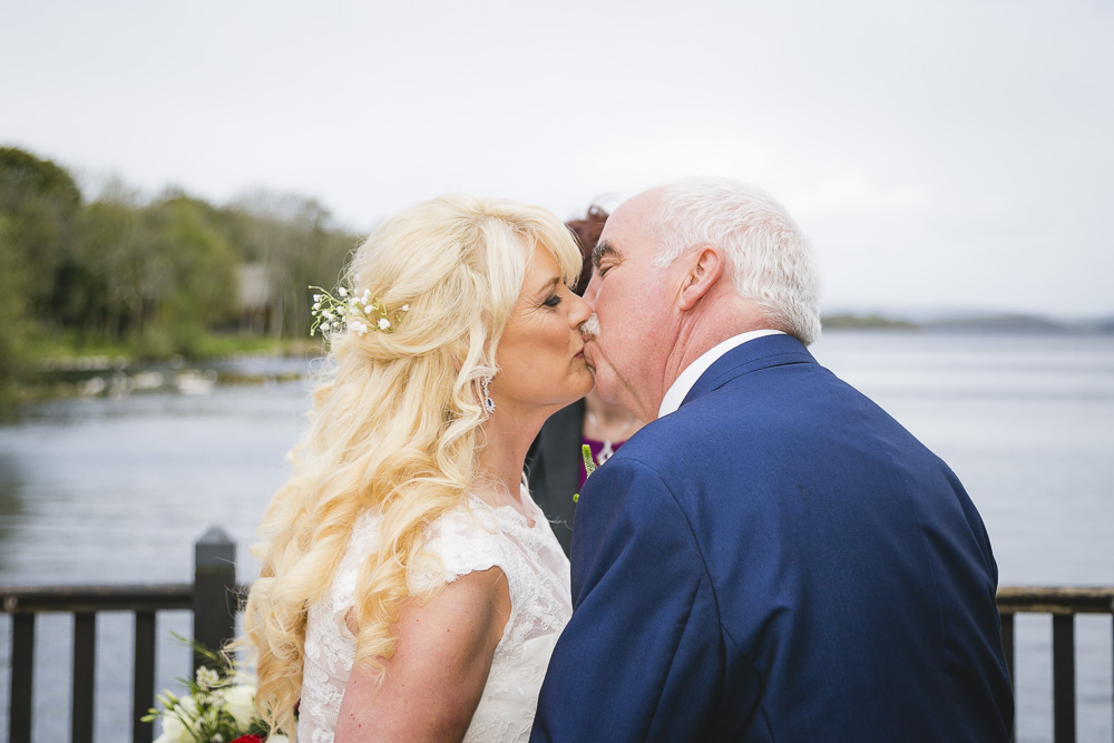 Lusty Beg Wedding Ceremony Kiss