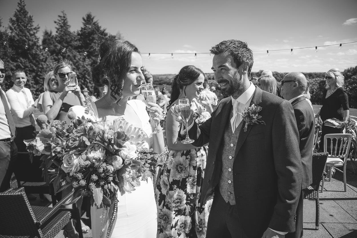Bride and groom enjoying champagne
