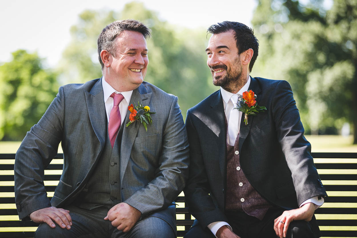 Groom and best man laughing