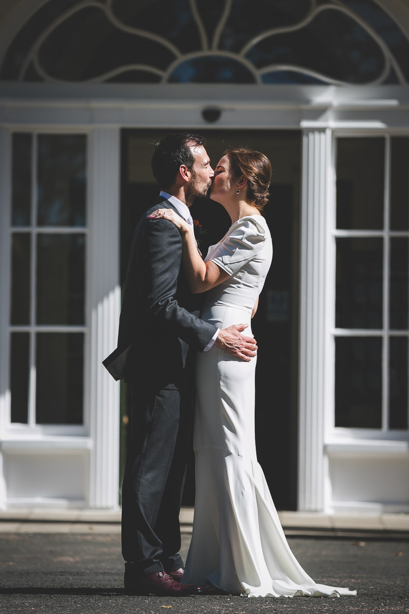Bride and groom at Malone House kissing