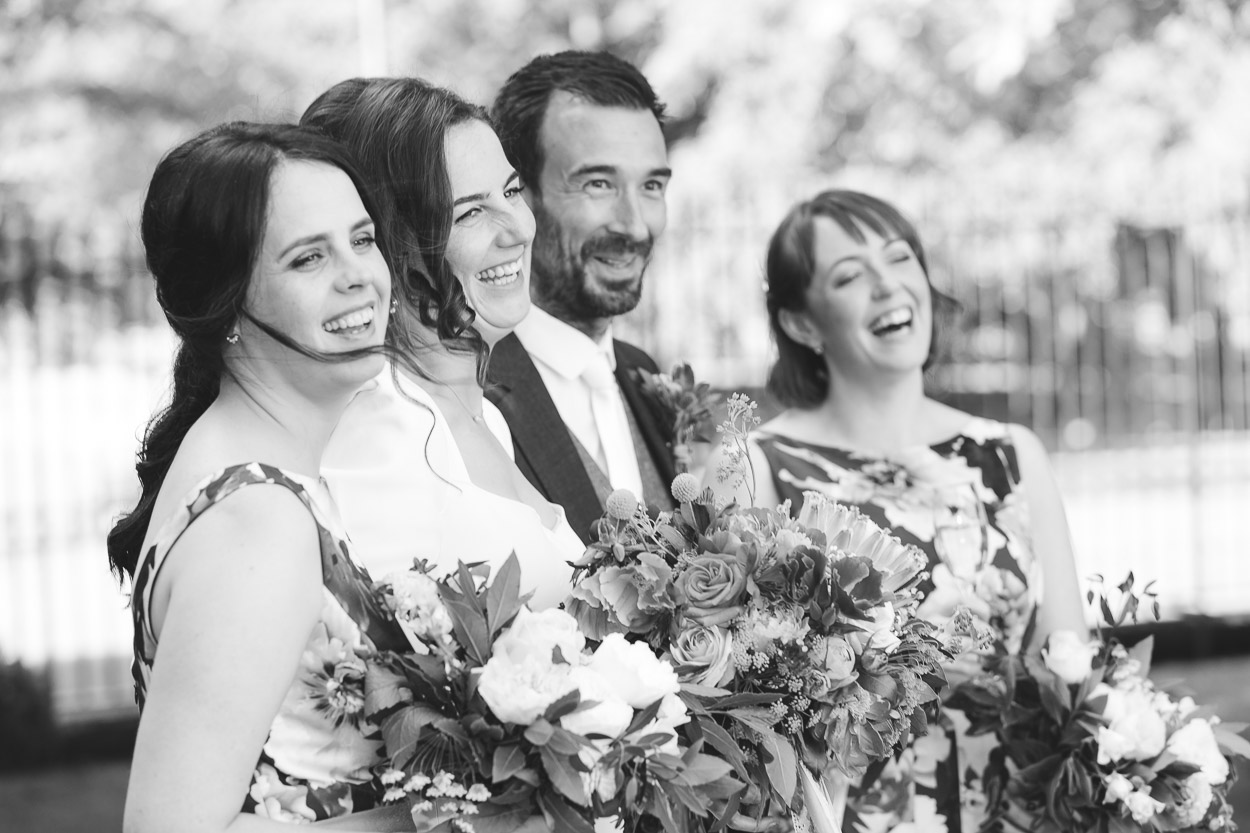 Couple with bridesmaids candid