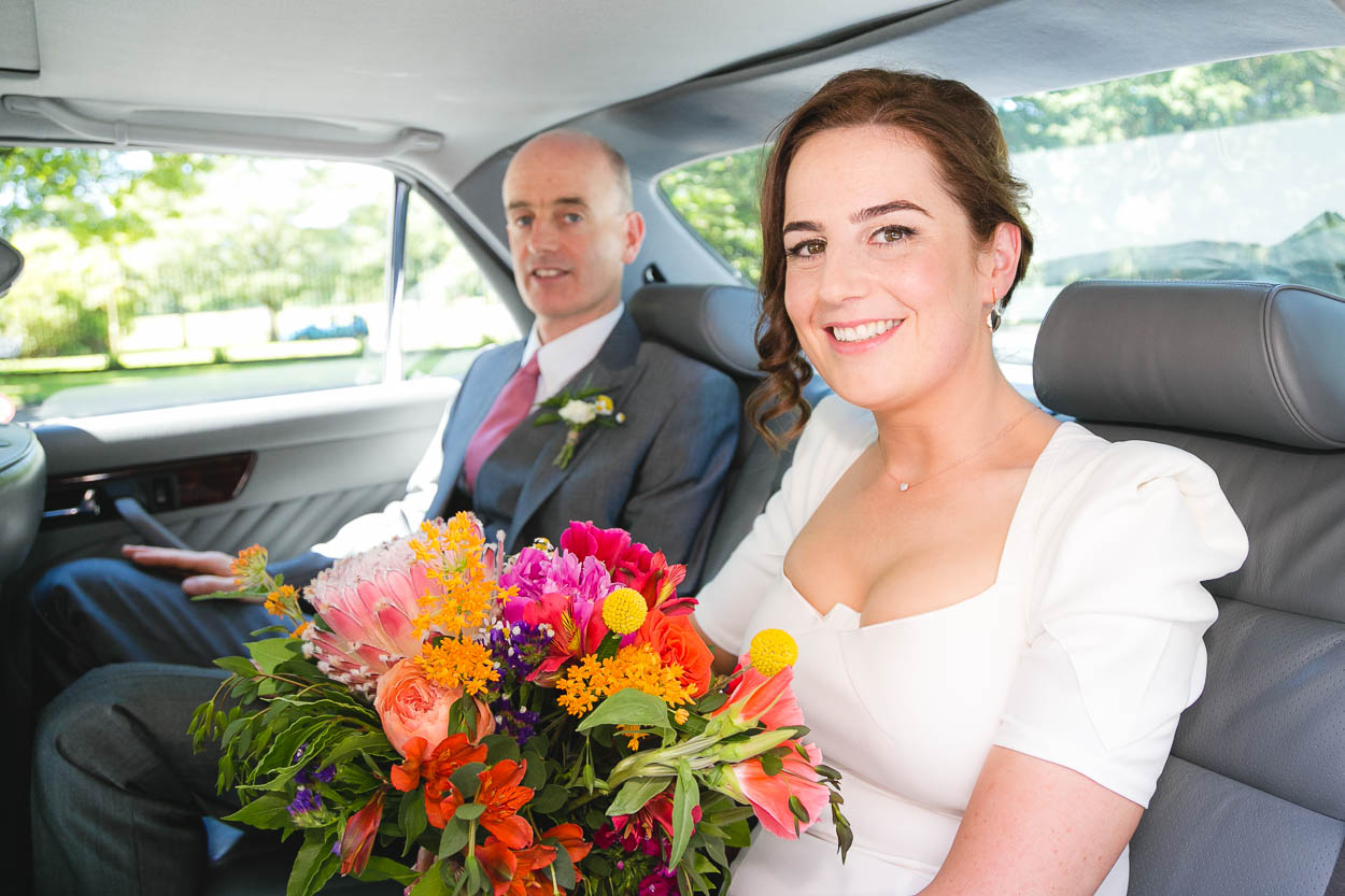 Bride's arrival with father in car