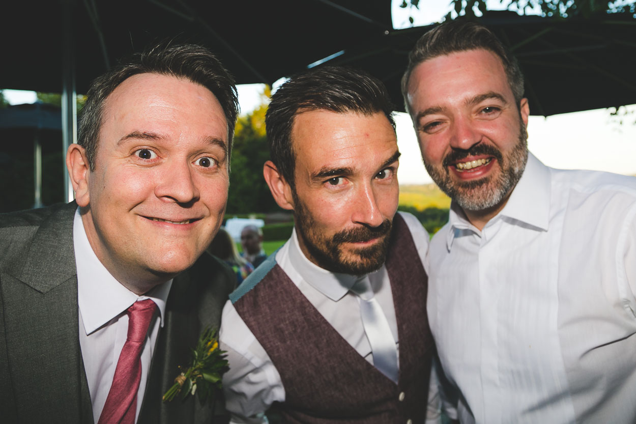 Groom posing with friends