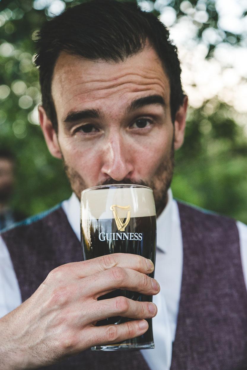 Groom enjoying a cold Guinness