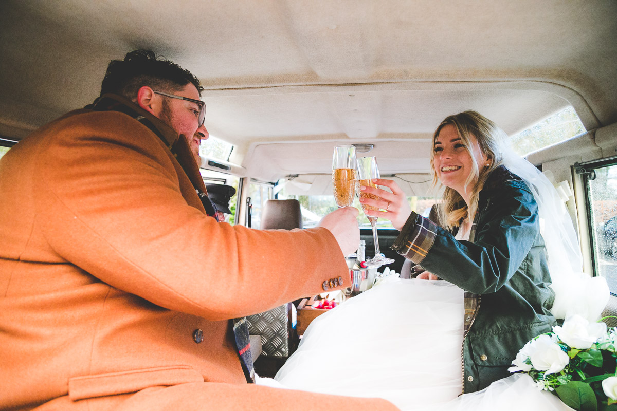 Wedding champagne in jeep