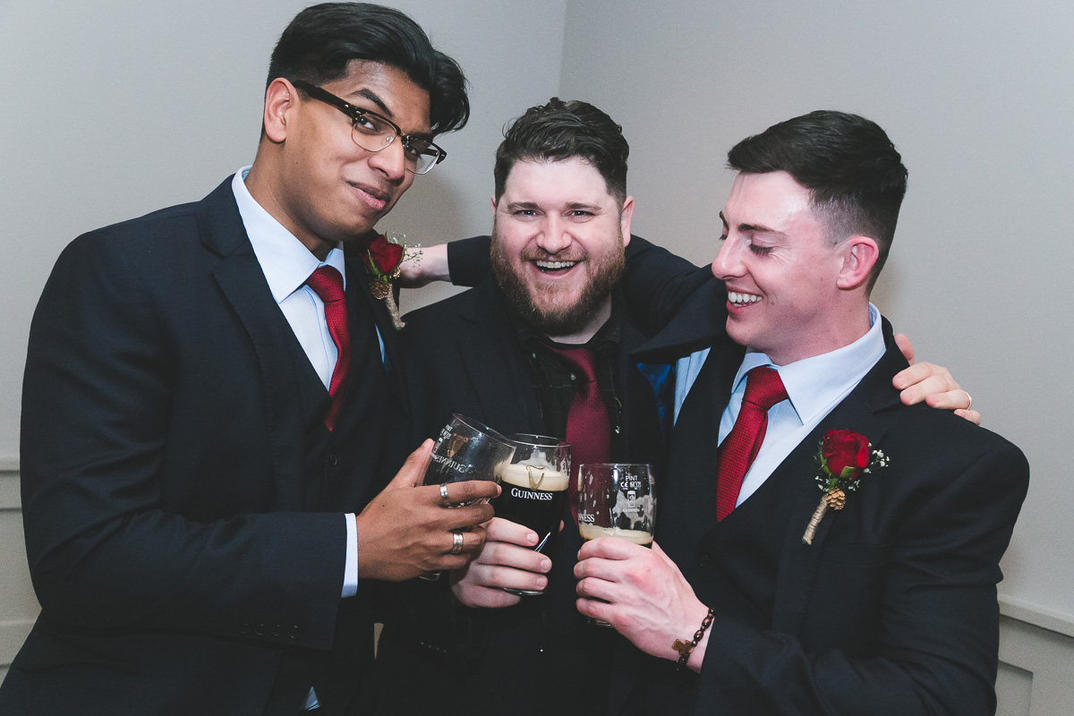 Groom celebrates with Guinness
