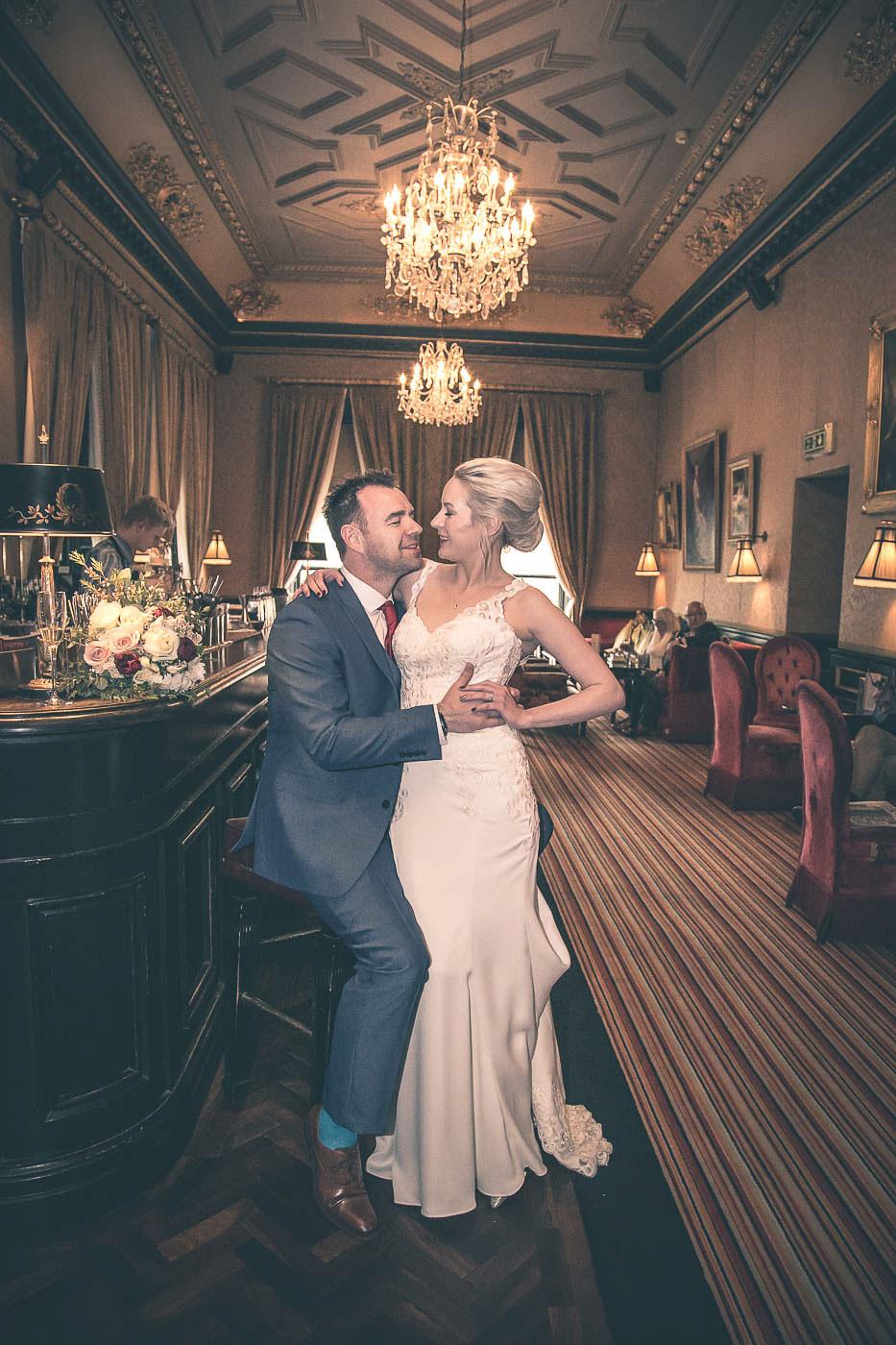 Merchant Hotel Wedding, kissing at the bar