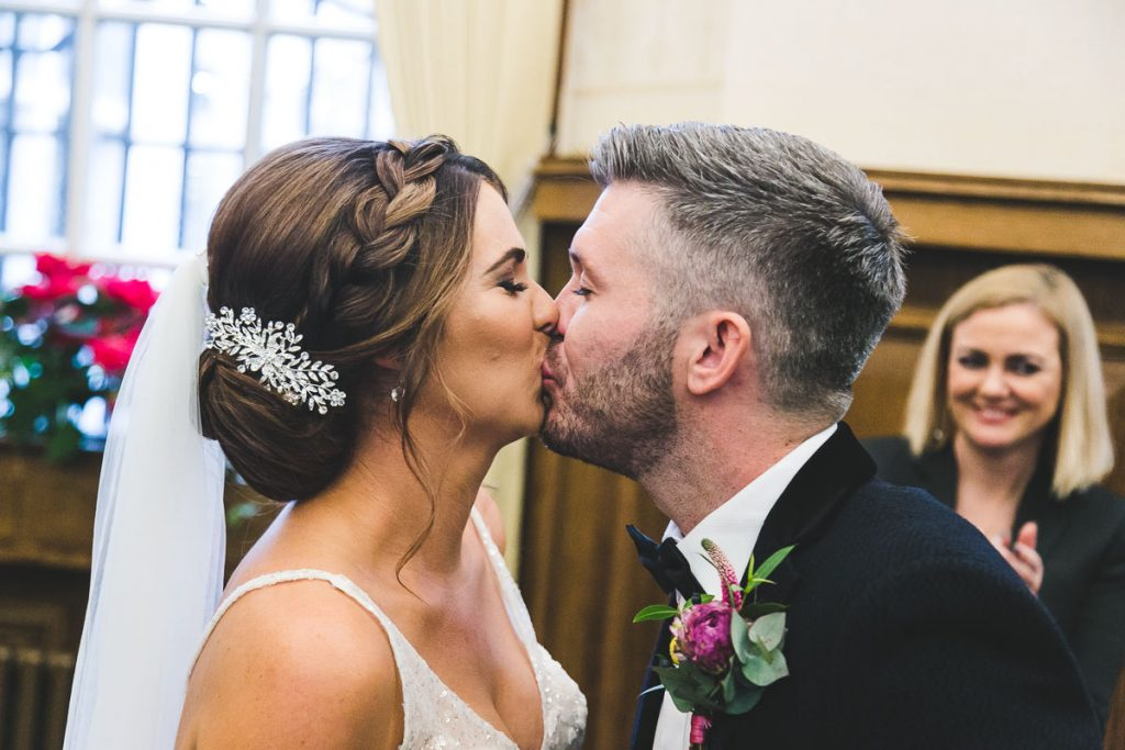 Belfast City Hall wedding bride and groom kiss