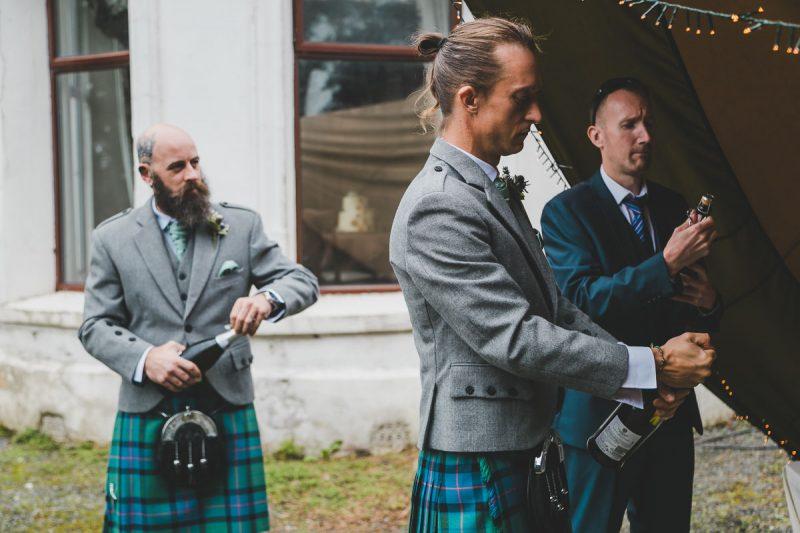 Seaforde Wedding Groomsmen Prosecco pouring